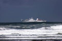 Ship at sea. In waves Royalty Free Stock Photos