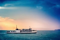 Ship at sea background of bright colored sunset Stock Image