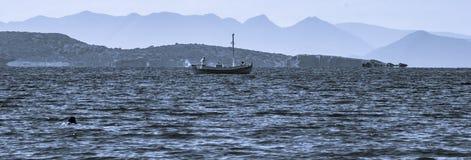 Ship on the sea monochrome stock photos