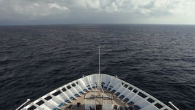 Ship at sea. Bow of ship moving through waves of the caribbean, view from ship