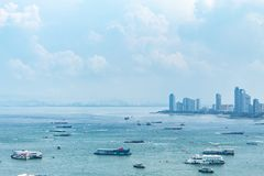 A ship in the sea and Cityscape view point of Pattaya beaches. stock image
