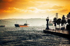 Ship in sea. Sea landscape with ship and lighthouse Stock Image