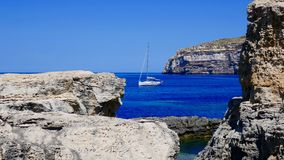 Yacht on the azuresea close to Malta's coast Stock Images
