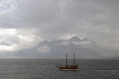 A ship at the sea in rainy weather Royalty Free Stock Photography