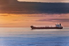 Ship on the sea and sunset background stock photo