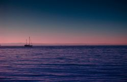 Ship on Sea during Sunrise Stock Photography