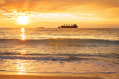 Ship, sea, sunset. Big ship lit by the rays of the rising sun Stock Images