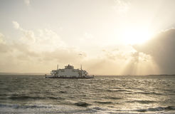 Ship on a sea during sunset Stock Image