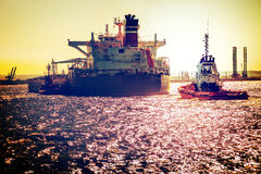 Ship on sea at sunset Stock Image