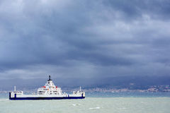 Ship at sea under dramatic clouds Sicily Italy Europe Royalty Free Stock Image