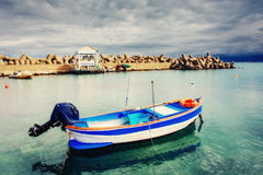 Ship at sea under dramatic clouds. Sicily Italy Europe Stock Image