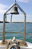 Ship at sea with view of lighthouse deck and bell Royalty Free Stock Photos