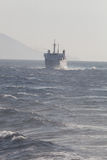 Ship in the sea. Waves and mist. A large ship traveling in the Mediterranean Sea. Repeated waves and light mist Stock Photography