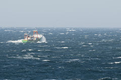 Ship seems to sink in the big waves of the arctic ocean tempest Royalty Free Stock Images