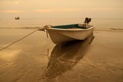 Ship. S bind to the sea beach in the evening Stock Image