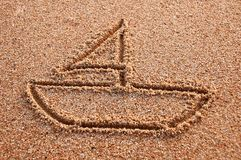 Ship sign. Drawn o a beach sand Royalty Free Stock Image