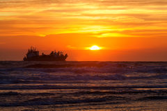 Ship silhouette on North sea at sunset Royalty Free Stock Photography