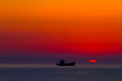 Ship silhouette at sunset Stock Photo