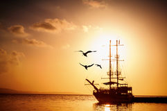 Ship silhouette at sunset Stock Photography