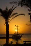Ship silhouette at sunset Stock Image