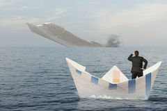 Ship is sinking into the sea. Concept of business crisis Royalty Free Stock Image