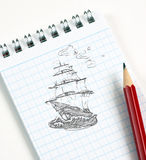 Ship sketch in pencil. In notepad stock image