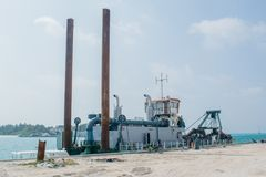 Ship standing in the port at the tropical island. Maamigili in Maldives royalty free stock photo