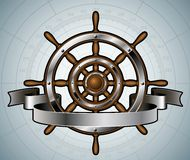 Ship steering wheel with banner. Royalty Free Stock Images