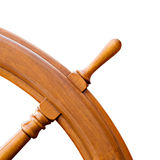 Ship steering wheel isolated on white. Ship steering wheel or helm - closeup corner isolated on white. Restored from old windjammer Royalty Free Stock Photography