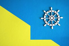 Ship steering wheel on yellow and blue background vector illustration