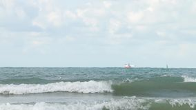Ship at storm wind in the sea. Strong wind lifts the water drop above the surface. stock footage
