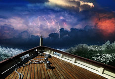 Ship in a stormy sea. And flashes of lightning on the horizon Stock Image