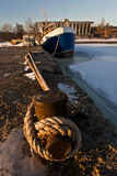 Ship stuck in frozen water. Industrial ship stuck in frozen water at the pier Stock Photo