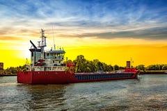 Ship at sunrise Stock Photo