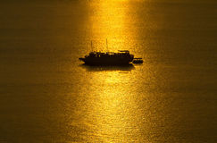 Ship on sunrise sea Royalty Free Stock Image