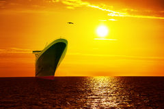 Ship on sunrise sea Stock Images