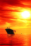 Ship at sunrise Stock Images