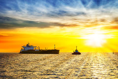Ship and sunrise Stock Photos