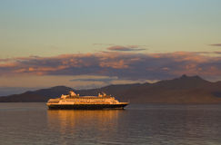 Ship During Sunset. Cruise ship in Alaska during sunset Stock Photo