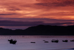 Ship at sunset. Fishing ship at sea with sunset royalty free stock image
