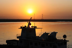 Ship at sunset Stock Images