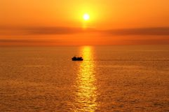 Ship in Sunset Royalty Free Stock Photos