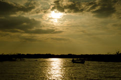 Ship at sunset on a lake in Indochina Royalty Free Stock Images