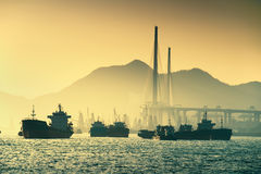 Ship and sunset in the ocean - Shanghai harbour stock photography