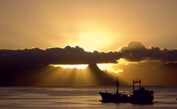 Ship in the Sunset over Mo'orea Royalty Free Stock Images