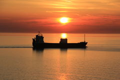 Ship in sunset Stock Photo
