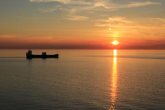 Ship in sunset. Ship sailing in sunset Kattegat Denmark Stock Photo