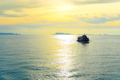 Ship in sunset scenery. Royalty Free Stock Photos