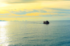 Ship in sunset scenery. Stock Photo