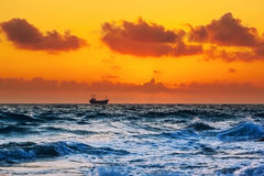 Ship on sunset in the sea Stock Photos